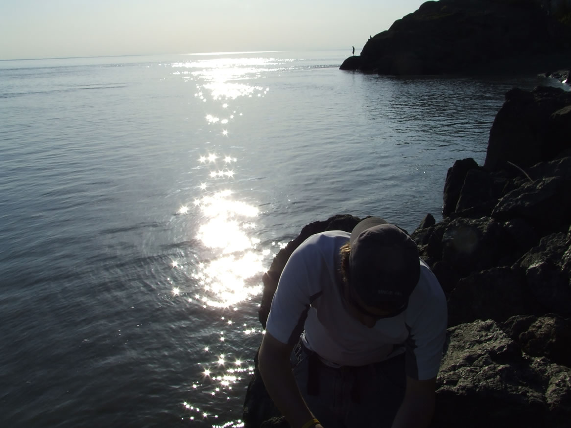Performing a clast count on the south side of the Beluga Point Outcrop